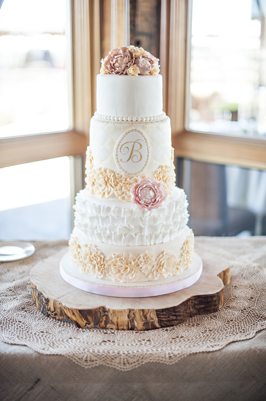 933911Z6wI_romantic-wedding-cake-with-lots-of-ruffles-and-sugar-peonies-and-a-hand-painted-monogram-by-sweet-and-swanky-cakes_900